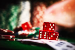 Poker Chips in casino gamble green table, dark vintage picture s Royalty Free Stock Photography