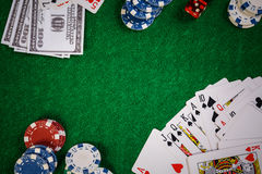 Poker Chips in casino gamble green table. stock photography