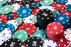 Poker chips on casino table close up Royalty Free Stock Photo
