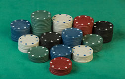 Poker chips on cloth Royalty Free Stock Photos