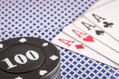 Poker chips and a combination of four aces Royalty Free Stock Image