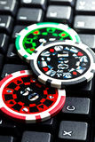 Poker chips on computer keyboard Royalty Free Stock Images