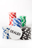 Poker chips and dealer button Stock Photography