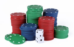 Poker chips and dice. Isolated on a white background Stock Image