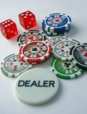 Poker Chips and Dice. Poker Chips, Dice and Dealer Chip on a white background Royalty Free Stock Photos
