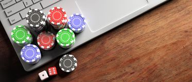 Poker chips and dice on computer laptop, wooden background, top view, copy space. 3d illustration stock illustration