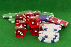 Poker chips and dice on green Royalty Free Stock Photos