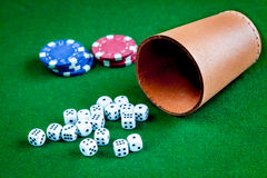 Poker chips and dice on green background Stock Images