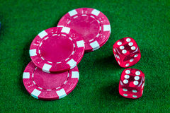 Poker chips and dice on green background top view Stock Images