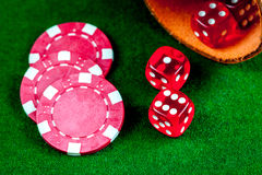Poker chips and dice on green background top view Royalty Free Stock Image
