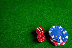 Poker chips and dice on green background top view Stock Photos