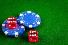 Poker chips and dice on green background top view Stock Image
