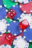 Poker chips and dice on the green table Royalty Free Stock Photography