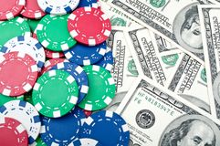 Poker chips and dolars Royalty Free Stock Images