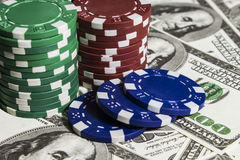 Poker chips with dolars Stock Photos