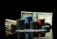 Poker chips and dollar bills Royalty Free Stock Images