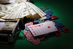 Poker chips and dollar bills Royalty Free Stock Photos