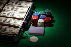Poker chips and dollar bills in case Stock Photography