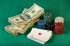 Poker chips and dollar bills Stock Photos