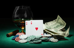 Poker chips and dollar bills Stock Images