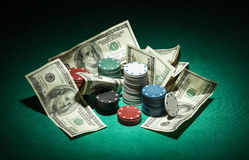 Poker chips and dollar bills Royalty Free Stock Photo