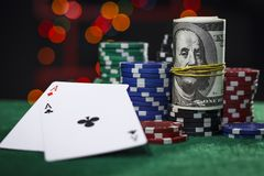 Poker chips, dollars and a pair of aces. Poker chips, some dollars and a pair of aces stock photography