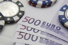 Poker chips with euro bills Royalty Free Stock Photo