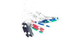 Poker chips falling into the water Royalty Free Stock Photo