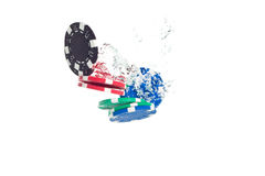 Poker chips falling into the water Royalty Free Stock Photos