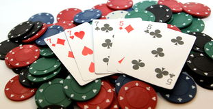 Poker chips and full house Royalty Free Stock Photos