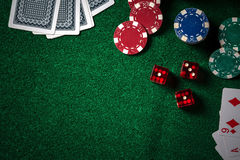 Poker chips and gamble cards on casino green table with low key. Lighting technical close up stock photo