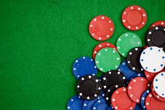 Poker chips on green background. Room for text Stock Photos