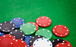 Poker chips on green background Stock Images