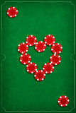 The poker chips on green background Stock Photo