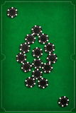 The poker chips on green background Royalty Free Stock Image
