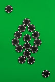 The poker chips on green background Royalty Free Stock Images