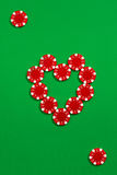 The poker chips on green background Stock Photos