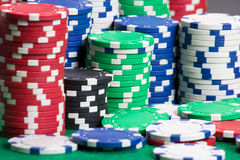 Poker chips on a green casino felt Royalty Free Stock Photography