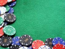 Poker chips on green felt table Royalty Free Stock Photo