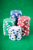 Poker chips on green playing table Stock Image