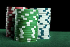 Poker chips on green table Stock Photo