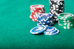 Poker chips on green table Stock Photography