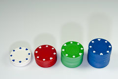 Poker chips - growing stacks Royalty Free Stock Image