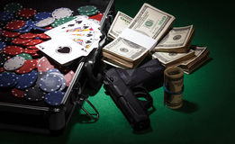 Poker chips and gun Stock Images