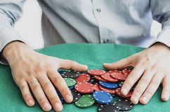 Poker chips and hands above them Royalty Free Stock Photos