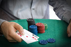 Poker chips and hands above them Royalty Free Stock Photography