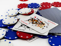 Poker Chips and Joker Cards on White Background. Piles of Poker Chips and Joker Cards on White Background Royalty Free Stock Photos