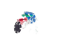 Poker chips jumping out of the water Royalty Free Stock Image