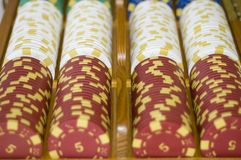 Poker chips in a line. A set of poker chips in a line with the value 5 at the front of the rows Royalty Free Stock Image