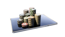 Poker chips on modern tablet Royalty Free Stock Photos